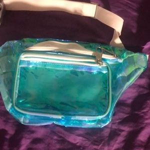 A holographic blue fanny pack from dickies